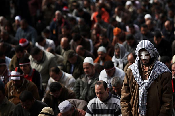 Egyptians pray in Cairo's Tahrir Square.