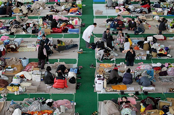 Residents of the areas near the stricken Fukushima nuclear power plant make do at an evacuation center in Yamagata, March 19.