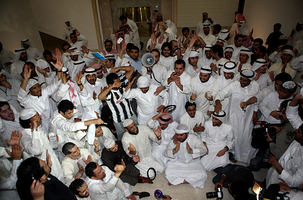 Thousands of Kuwaitis stormed parliament after police and elite forces beat up protesters marching on the prime minister's home to demand is resignation.