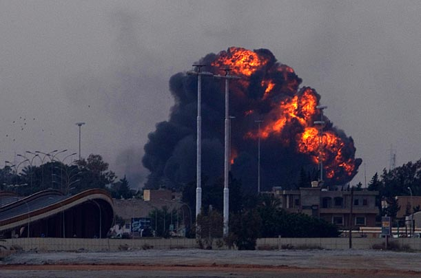 A huge explosion, erupts over Benghazi, after the plane was shot down.  Read more: http://www.time.com/time/photogallery/0,29307,2053369,00.html#ixzz1JXVcXZe0