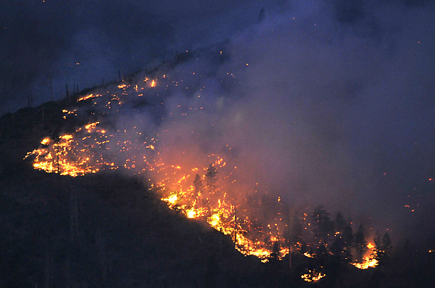 Flames consume vegetation on the Jemez Mountains, near Los Alamos, New Mexico, June 28, 2011.