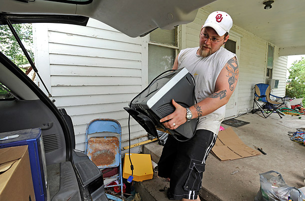 Joe Hill loads electronics into his car during a mandatory evacuation from projected flooding.