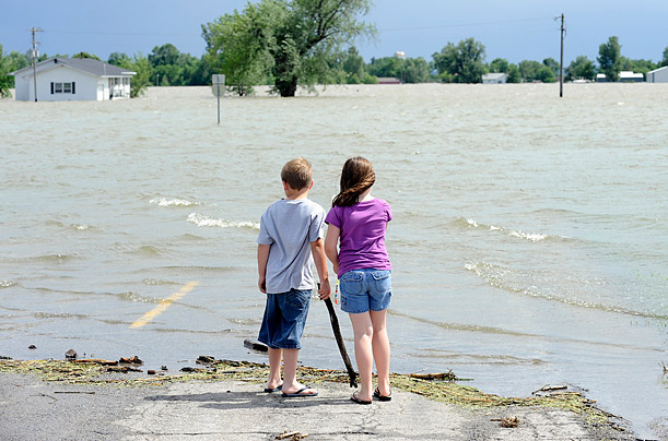 Jarrett and Jessica Hunter watch the overflowing Missouri River that flooded Corning, Missouri on June 21, 2011.