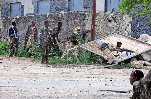 Somalia Transitional Government soldiers take positions near Mogadishu stadium after a brief fight with Al Shabaab fighters.