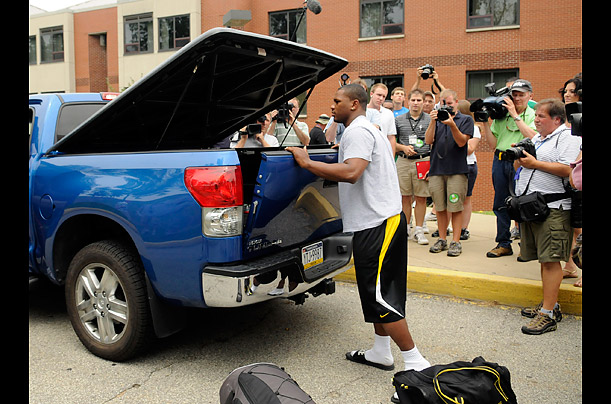 Steeler running back Issac Redman unloads his gear in front of the team training facility in Latrobe, Pennsylvania,  July 28, 2011.
