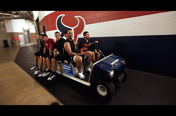 Quarterback Matt Schaub rides in the front passenger seat on the first day the camps were open,  July 26, 2011.