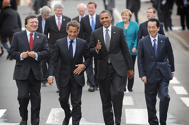 President of the European Commission Jose Maneul Barroso, left, French President Nicolas Sarkozy, U.S. President Barack Obama and Japanese Prime Minister Naoto Kan, right, walk to lunch after their first meeting on the first day of the G8 Summit.