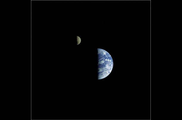 A composite image shows the earth and its moon. The Earth is roughly four times the size of the moon.