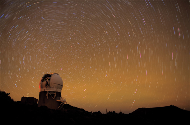 The Pan-STARRS 1 telescope complex in Maui, Hawaii maps the sky in a time-lapse photograph.