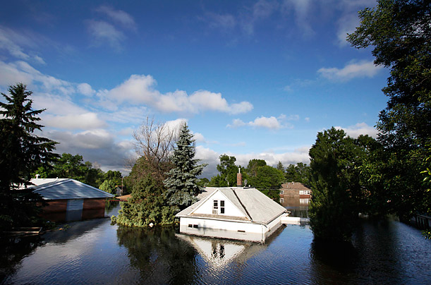 Floodwaters from the Souris River surround homes on 3rd St. near Minot State University.