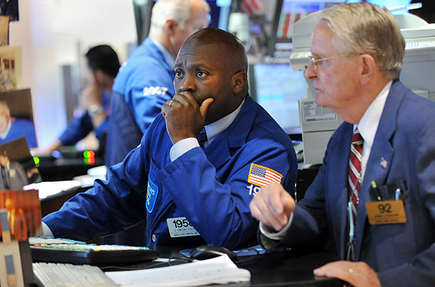 Traders work on the floor of the New York Stock Exchange before the Closing Bell in New York, USA, on Tuesday,  August 8, 2011.