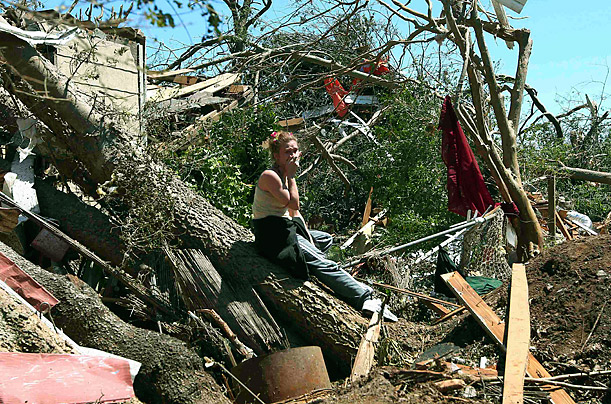 Tracy Hannah reacts after returning to her house for the first time since a tornado swept through the Alberta community near Tuscaloosa, Alabama, April 29, 2011.