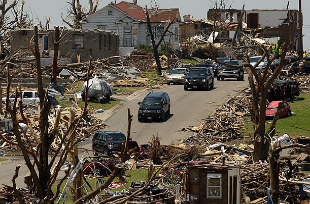 A motorcade carrying President Obama passes through a devastated Joplin, Mo., neighborhood Sunday, May 29, 2011.