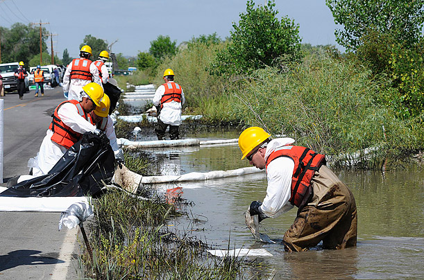 The rupture of an Exxon Mobil pipeline releases almost 1,000 barrels of oil into a flood-swollen river.
