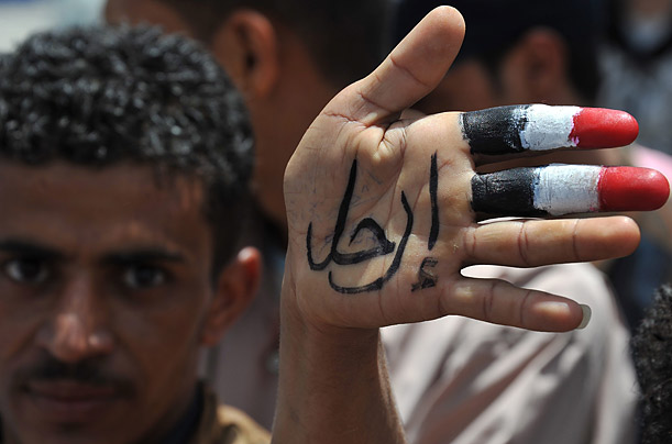 The slogan on the hand of this young man photographed at a demonstration calling for the end of Saleh's government reads,