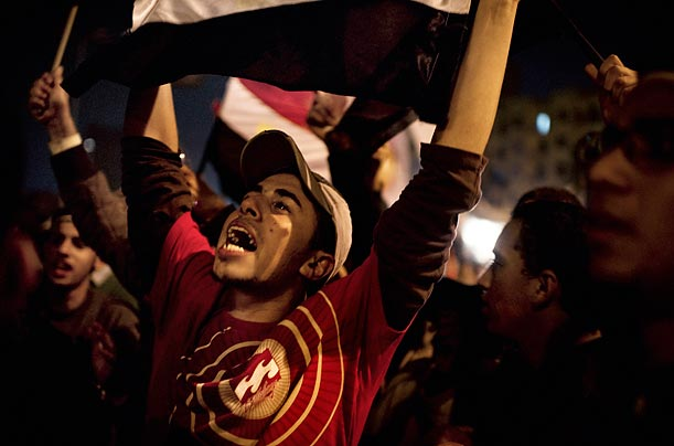Anti-government protesters rejoice after Vice President Omar Suleiman's announcement of Hosni Mubarak's resignation on the 18th night of protests.
