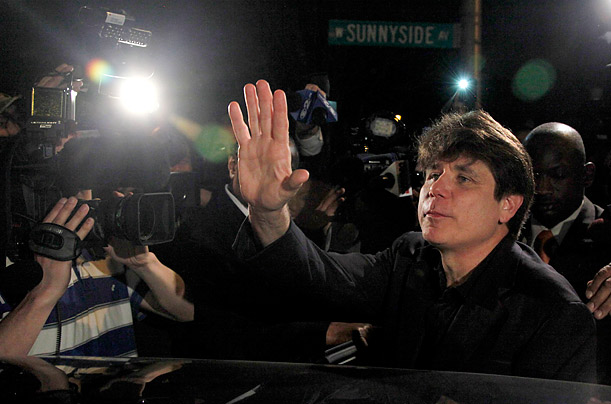Former Illinois Gov. Rod Blagojevich waves to the media as he departs his Chicago home for Littleton, Colorado, to begin his 14-year prison sentence on corruption charges March 15, 2012.