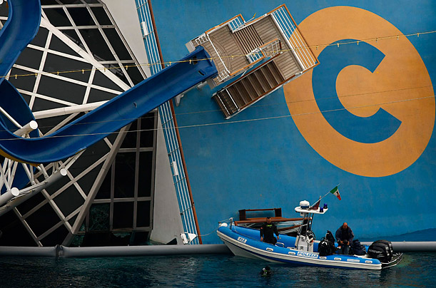 A scuba diver inspects the inside of the Costa Concordia cruise ship which ran aground off the west coast of Italy by the island Giglio in this still image taken from video shot by Italian firefighters