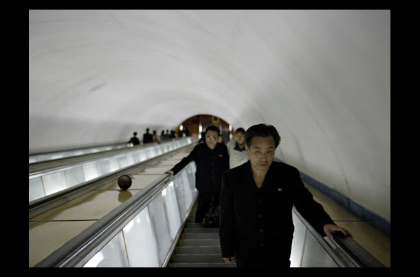 Commuters ride the escalators at an underground train station in Pyongyang, North Korea