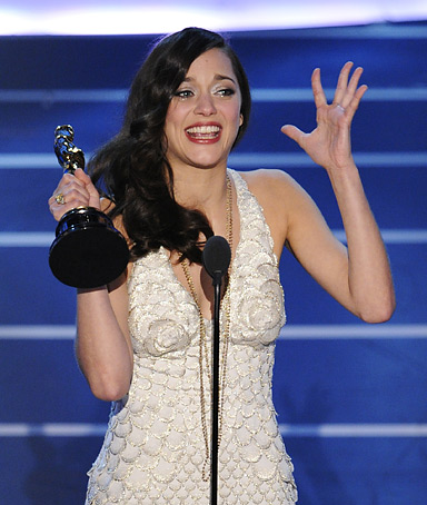 French actress Marion Cotillard accepts the Oscar for best actress for her work in