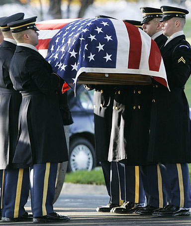 Honor guard carry a coffin during a funeral ceremony at Arlington National Cemetery