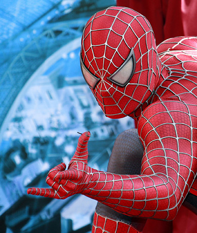 A man dressed as American DC comics hero Spiderman poses for the press at the Hollywood theme park Universal Studios Japan, which has an attraction titled the