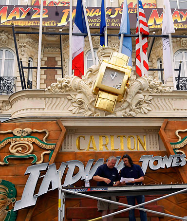 Workers put up an advertising sign of Indiana Jones and the Kingdom of the Crystal Skull on the facade of the Carlton hotel, on the eve of the opening of the 61st International film festival in Cannes, southern France