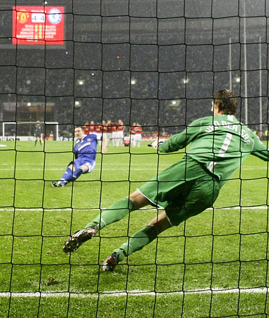 Chelsea's John Terry (L) misses a penalty shot against Manchester United's goalkeeper Edwin van der Sar during their UEFA Champions League final soccer match at the Luzhniki stadium in Moscow May 22, 2008.