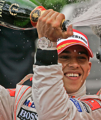 McLaren Mercedes driver Lewis Hamilton of Britain sprays champagne as he celebrates after winning the Formula One Monaco Grand Prix, at the Monaco circuit, in Monaco, Sunday, May 25, 2008