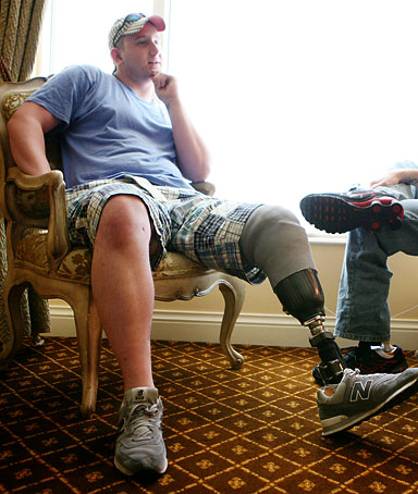 Marine corporal Jimmy Kinsey, 23, left, and lance corporal Kyle Riley, 21, relax in their penthouse suite at the Venetian hotel-casino Sunday, May 25, 2008, in Las Vegas