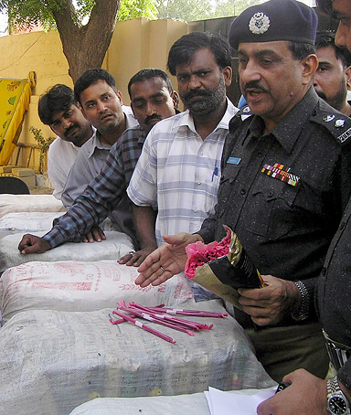 Police officials show piles of Hashish seized from smugglers in Karachi, Pakistan, 25 May 2008. Police in Karachi seized huge quantity of Hashish which was being smuggled to Karachi from Pakistani town of Chaman along the Afghanistan border.