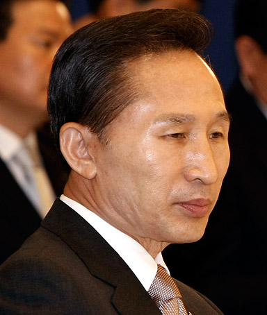 South Korean President Lee Myung-bak participates in a a meeting with representatives of small and medium-sized enterprises at the presidential house in Seoul, South Korea, Wednesday, June 11, 2008