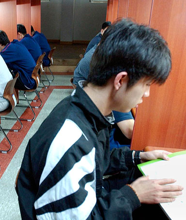 South Korean students study in a private cram school at Chorwon, outside Seoul, Thursday, April 24, 2003