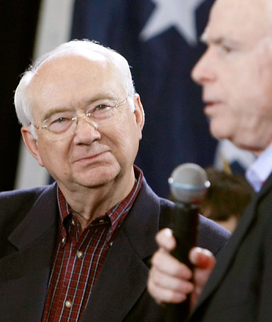 U.S. Sen. Phil Gramm listens to his colleage presidential hopeful Sen. John McCain speak during a rally.