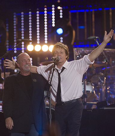 Billy Joel, left, and Sir Paul McCartney perform during the Billy Joel