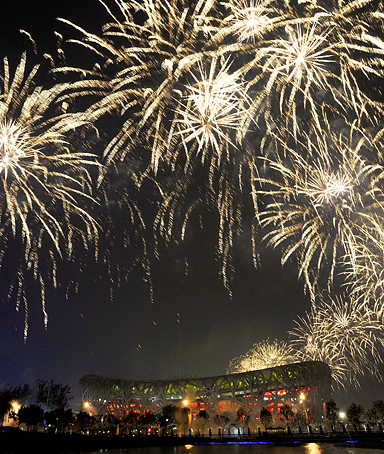 Fireworks explode during the closing ceremony of the Beijing Olympic Games at the National Stadium in Beijing on