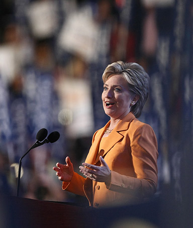 U.S. Senator Hillary Clinton (D-NY) is seen through supporters' signs as she addresses the 2008 Democratic National Convention in Denver, Colorado August 26, 2008.