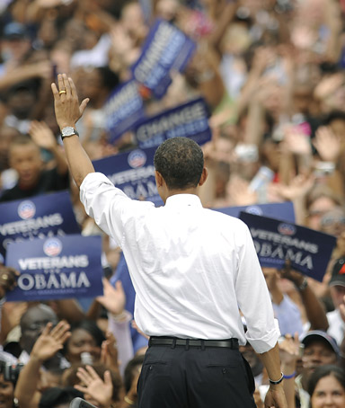 US Democratic presidential candidate Illinois Senator Barack Obama waves at a rally in Charlotte, North Carolina, September 21, 2008.