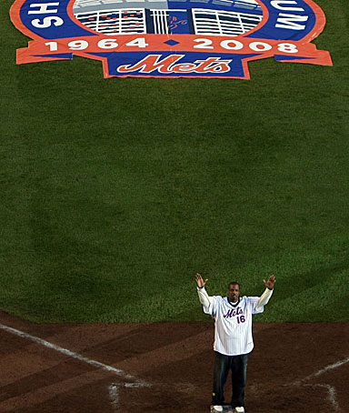 Former Mets pitcher Dwight Gooden greets fans from the field in a post game ceremony after the last regular season baseball game ever played in Shea Stadium against the Florida Marlins on September 28, 2008