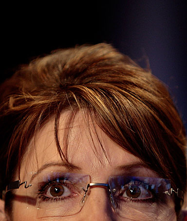 Republican vice-presidential candidate Alaska Gov. Sarah Palin listens from the audience to Sen. John McCain's speech at the Clinton Global Initiative meeting September 25, 2008 in New York City.