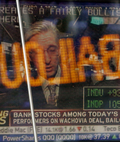 The Dow Jownes news ticker is reflected in a television monitor at the NASDAQ headquarters in New York's Times Square announcing the passing of the Wall Street bailout bill, Friday, Oct. 3, 2008.