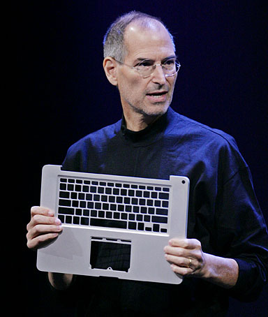 Apple CEO Steve Jobs holds up a new aluminum frame for a MacBook Pro during product announcement at Apple headquarters in Cupertino, Calif.