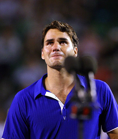 Roger Federer of Switzerland sheds tears during the awarding ceremony after the men's singles final against Rafael Nadal of Spain at Australian Open tennis tournament in Melbourne, Australia, Feb. 1, 2009