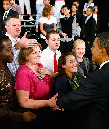 President Obama greets people during a Town Hall Meeting in Fort Myers, Florida.