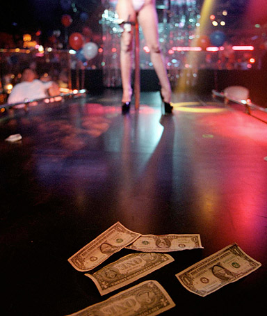 A stripper receives tips.