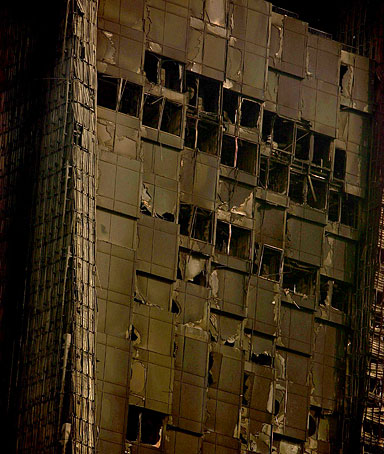 Part of fire damaged Mandarin Oriental hotel building is seen in Beijing's central business district, China, Tuesday, Feb. 10, 2009