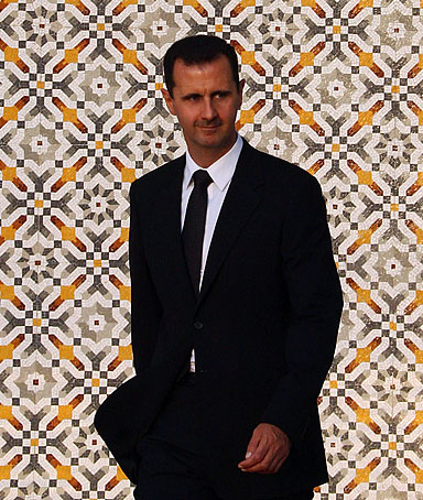 Syrian President Bashar al-Assad arrives to greet his French counterpart Nicolas Sarkozy in Damascus on September 3, 2008