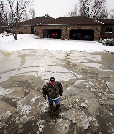 Vic Klosterman walks through flooding from the Red River in front of his home south of Fargo, North Dakota