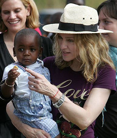 Madonna holds David Banda in her arms in Mchinji, Malawi