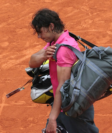 Spanish player Rafael Nadal leaves the court after loosing to against Swedish player Robin Soderling during a French Open tennis  round of 16.